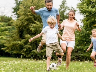 Active family play soccer in their leisure time